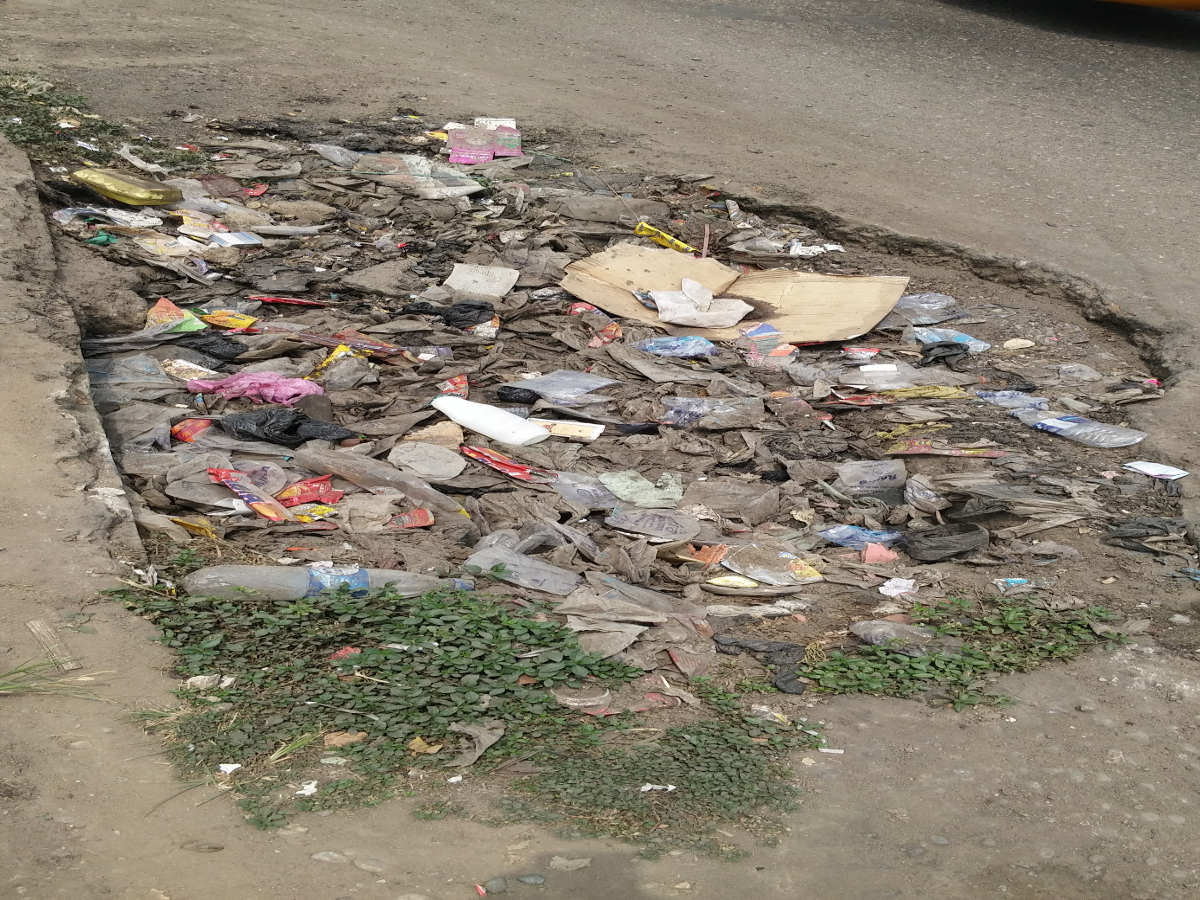 Pothole filled with Waste near BATA
